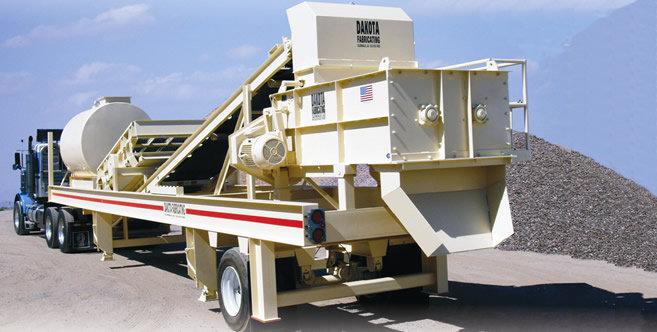Pugmill mixer system on portable chassis designed for through-put